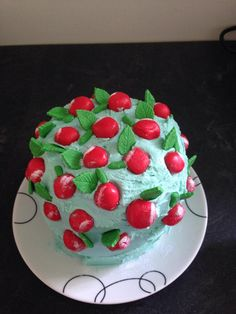 small cherry decorated cake with butter icing