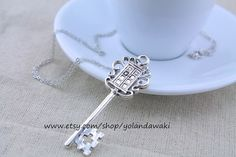 antique silver Tardis key necklace by yolandawaki on Etsy, $4.66.  This one, or the antique-ish one?