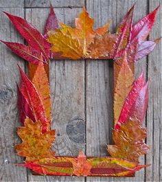 #DIY #FallLeaves Picture Frame: Mod Podge pressed fall leaves over an old frame. #TreeCrafts #FallCrafts #FallFoliage