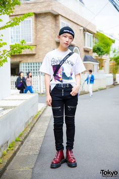 Today, Motoshige's outfit consists of a t-shirt by the Korean streetwear brand Dododo, black zipper pants from Another Youth, cherry red buckle boots from the Dr Martens x Agyness Deyn collection and a Basic Cotton sling bag. He accessorized with Fucking Awesome bonnet, ear cuffs and chain earrings, silver rings and a black grommet belt.