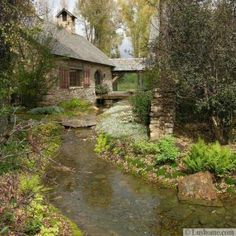 Mysterious and beckoning, this cottage in the Wyoming forest has an undeniable draw. Traditional Landscape by OSM Wyoming, Inc. Cottage In The Woods, Cozy Cottage, Cabins In The Woods, Cottage Homes, Cottage Style, River Cottage, Forest Cottage, Irish Cottage, Romantic Cottage