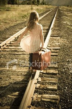 stock-photo-1752798-little-girl-with-suitcase-walking-down-train-tracks.jpg 253×380 pixels