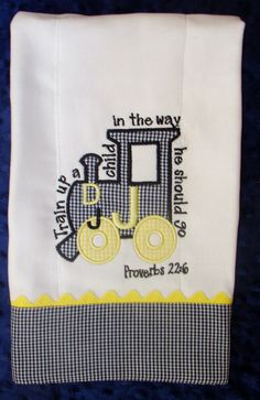 Appliqued burp cloth with monogram. $8.00, via Etsy.