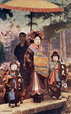 Tayuu with her Kamuro 1904    This is an image from an English postcard postmarked 1904. The mellow colours are lovely, but not really in keeping with the sumptuous appearance of a Japanese Courtesan and her retinue.