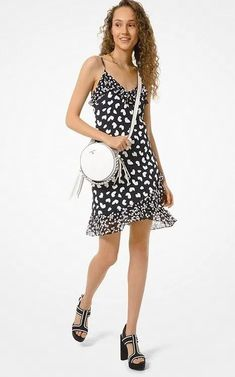 Black and White Floral Petal Viscose Sleeveless Summer Slip Dress With Ruffle Hem. Black and White Summer Ruffle Hem Cocktail Dress With Spaghetti Straps. Black and white graphic slip dress, printed with a heart-shaped petal motif and finished with ruffle trim. Adjust the spaghetti strap #summerfashion  #summerstyle #summervibes  #fashionstyle #SummerStyle #SummerDresses Black And White Plus Size Dresses, Black And White Cocktail Dresses, White Floral Dress, Striped Dress, Michael Kors, Classic Outfits, Summer Dresses For Women, Latest Fashion Trends, Messenger Bag