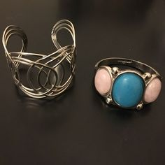 Bracelet bundle! Two cute bracelets. Silver bangle that can be adjusted to fit any size wrist and can go with anything! Silver bracelet (has clasp) with pink and turquoise stones to add a little color to your outfit! Jewelry Bracelets