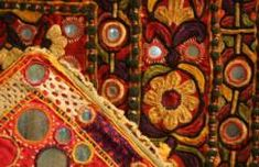 Multi-coloured embroidery including mirrors and flower motifs