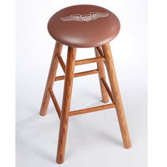 """Pilot Wings Oak Bar Stool (brown top) - Sporty's Wright Bros Crafted from Oak Wood  We've taken a comfortable 15"""" dia. padded bar stool seat and placed pilot wings on it to give your home bar, kitchen, or workshop some aviation style! Quality swivel-seat Stool features real oak-wood legs and footrest for comfort. Bar Stool sits 30""""h. Silk screening process uses special paint to ensure logo is long-lasting. 10 year limited warranty."""