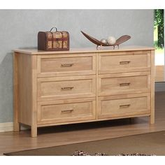 Store your clothes and belongings in an organized manner with this six-drawer dresser from Olympus. A dark blonde birch finish and metal drawer pulls complete this dresser.