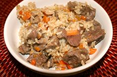 Ingredients  1 package of beef chunks/chi8cken  1 cup white rice, rinsed and drained  1 large carrot, sliced in thin strips  1 medium onion, finely chopped  1 tablespoon butter  2 cups water  Salt and pepper to taste  8 cloves of garlic  olive oil    Russian Plov , Russian Rice (beef or chicken) Pilaf .. I would make with chicken instead