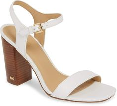 A towering demi-block heel and a softly blunted toe dramatically shape a sandal styled with simple straps and pops of gleaming logo hardware. Nordstrom Beauty, Block Heel Shoes, Michael Kors Shoes, Looking For Women, Leather Sandals, Peep Toe, Queen Headboard, Shape, Logo