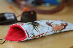 Easy quilted eyeglasses cases for you to make and personalize with buttons and fun fabric choices.