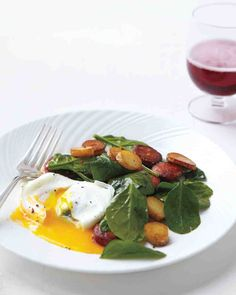 New Spinach Salad with poached eggs and chorizo
