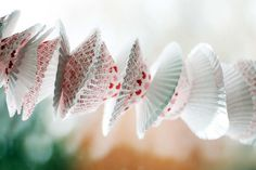 Cupcake wrapper garland. this one is ugly ... but a fun, quick & easy idea (as long as you use cute wrappers)!