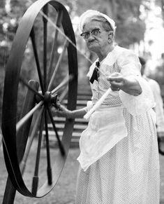 Spinning thread on the wheel. (1950s) | Florida Memory