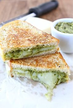 Parmesan Crusted Pesto Grilled Cheese Sandwich on twopeasandtheirpod.com One of my favorite grilled cheese!