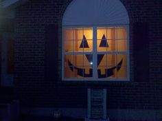 Easy Halloween decoration with big impact! Face is black construction paper. Window is covered with orange tissue paper. Put lamp behind window to give it a glow!