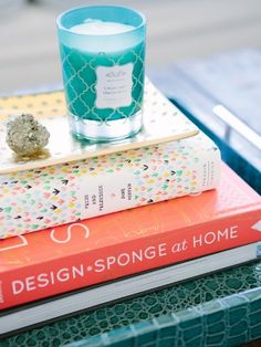 Top Stacks With Tiny Touches  A table grounded by trays and books can carry little sparkly accents, like gemstones or candles, without the look seeming slight. Plus, candle colors and scents can be easily swapped out with the seasons.