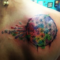 """Flower of life watercolor tattoo with the quote """"the unexamined life is not worth living"""" in Ancient Greek words by Socrates"""