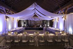Elaborate draping of the Fearrington Barn creates a more dramatic setting for a wedding reception
