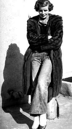 Katharine Hepburn  I know this woman was eccentric but the blue jeans are just over the top. Blue jeans were considered to be just ghastly until the '60's and the fur too???!!  beyond avant-garde!! just too good to be true.