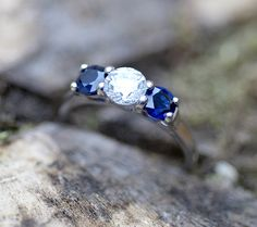 Gorgeous engagement ring, two 30pt blue sapphires and one stunning 60pt diamond.