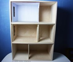 Build this easy front opening dollhouse or dolls house style bookcase using free plans and a single sheet of Baltic Birch plywood.