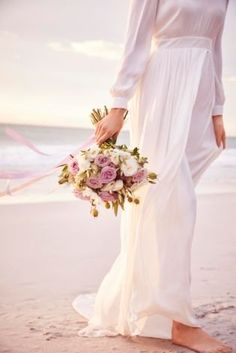 Our beautiful soft floaty floor sweeping Bridal gown with long sleeves, split back and train will make any bride feel sophisticated and elegant on their special wedding day.