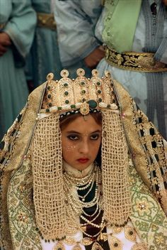 Young bride wearing golden braided robe. Fezzi wedding are considered as the most elaborated. 1984, Bruno Barbey