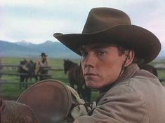 When John Wilder was asked to write Return to Lonesome Dove, the sequel to Lonesome Dove, he elevated the role of Newt, reprised by actor Ricky Schroder, into one of the central roles of the miniseries. Ricky Schroder, Chuck Connors, Lonesome Dove, Indian Boy, Cowboys And Indians, Western Movies, Steve Mcqueen, In Hollywood, Cowboy Hats