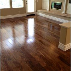 Walnut flooring for basement remodel! Love look but might be too expensive for whole basement. Maybe Maple stained a little lighter color. (Dust wont show as much : ) ) Cost Of Wood Flooring, Walnut Hardwood Flooring, Modern Flooring, Flooring Ideas, Wood Look Tile Floor, Floor Stain, Laminate Stairs, Color Dust, Basement Remodeling