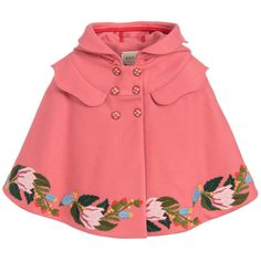 Keep girls cosy and warm when the weather gets chilly with this luxurious, mid-weight cape by iconic Italian designer Gucci. Made in pure pink wool, it is double-breasted with floral buttons and has gorgeous floral embroidery all around the hemline. Soft pale blue cupro satin patterned with bows lines the cape beautifully.