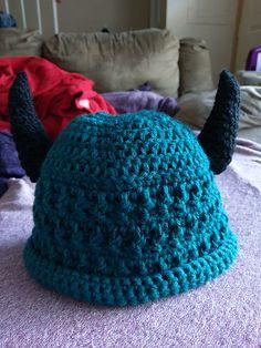 Ravelry: RemnantsCrafts' Horned Messy Bun Hat