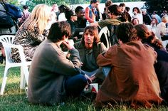 Liam Gallagher of Oasis sits on the grass with a group of people,. Gene Gallagher, Lennon Gallagher, Liam Gallagher Oasis, Liam Oasis, Oasis Music, Big Brother 20, Liam And Noel, Finsbury Park, Thanksgiving Day Parade