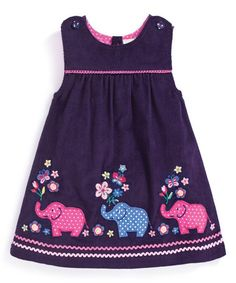 Perky pachyderms add playful panache to this timeless dress, and pure cotton coddles your princess with skin-pampering comfort.