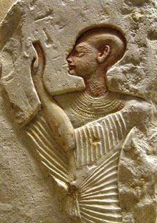 Orant priest, arms raised before a deity, or ancestor figure. 19th dynasty. Egypt.