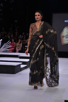 Black georgette saree with lace patchwork and kalamkari blouse.