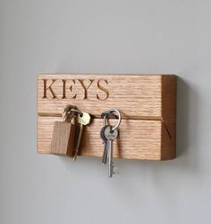 A truly innovative Key holder. Hand engraved in solid oak in our workshop, it has a contemporary look and is really quite eye catching.With 'KEYS' engraved (£55) With your own engraving of up to 9 characters (£65)This will solve that problem that we all struggle with at times, the 'have you seen my keys?' question. With this in mind we think it will be much appreciated by everyone in the house! A perfect gift for a friend or member of the family or just a sensible purchase for yo...