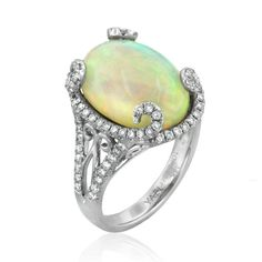 Savu ring set wuth a 6.58ct opal accented with white diamonds by Yael Designs #opalsaustralia