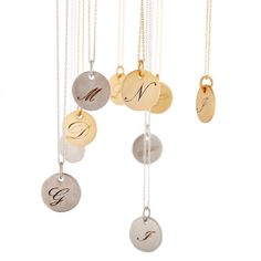 Tag necklaces with engraved pendants. Make it yours with letters of your loved ones