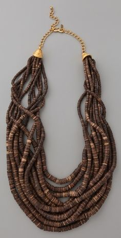 You can throw this on all summer long and look pulled together. Kenneth Jay Lane  Dark Wood  Bead Necklace