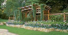 Trellis + Arbor combo - no privacy fence.  Look at the hostas!  By Keenan & Sveiven Landscape Architecture, Minneapolis, Minnesota   Portfolio: Wood