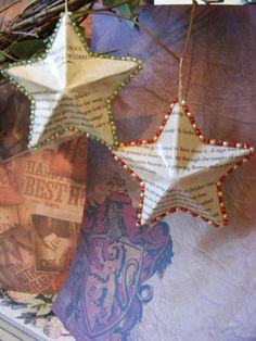 Harry Potter Book Page Christmas Ornaments - decoupaged on to star-shaped paper mache ornaments.  edges embellished w/ seed beads from the different houses. pretty cute.