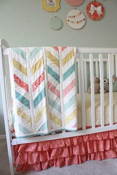 Coral, yellow, teal girl nursery colors, love the ruffle bed skirt