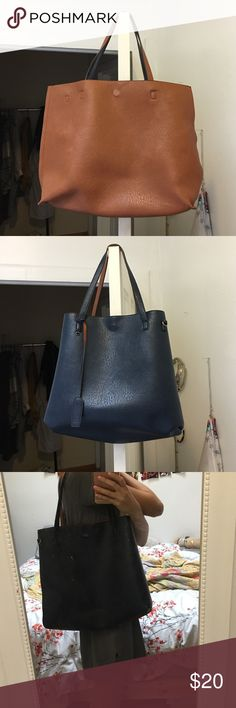 Reversible vegan leather tote Super cool reversible vegan leather tote! It's two bags in one. When it is tan it is bigger then flip it inside out and it becomes a navy blue purse. Very popular at urban outfitter and I'm not sure if they still make this color. There is also a tiny brown mark that is pictured above. Urban Outfitters Other