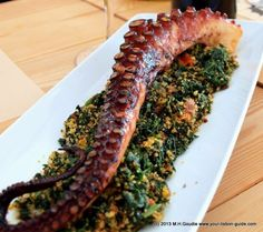 Big Daddy Tentacle This colossus of a slow roasted fresh grilled octopus tentacle sits proudly at top spinach, dill, tomato and garlic with a smattering of crunchy corn bread crumbs thrown in.   Read more: http://www.your-lisbon-guide.com/news/octopus-eating-chefs-at-the-fish/