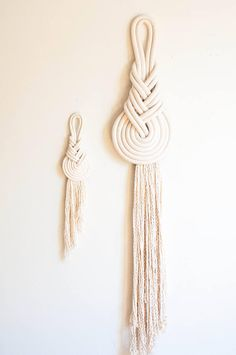 An ancient Chinese knot, dating back thousands of years, created to look like the pear shaped string instrument--the Pipa. Wall hanging pictured is a medium. Please select your preferred size of knot. Small: 6.5 x 16 Medium 8.5 x 26 Large 12.5 x 42 Each knot is made to order from
