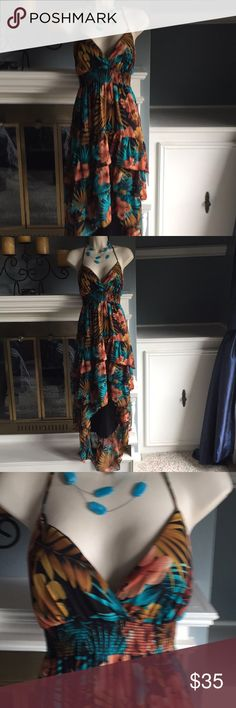 Tropical ruffled high low maxi dress halter medium Gorgeous floral tropical print in teal and brown black. Halter neckline. Ties behind the neck. Slightly padded bus line with structure for a great fit. Ruffled High Lo skirt. Semi sheer fully lined. Perfect condition - worn once Va Va Voom Dresses High Low