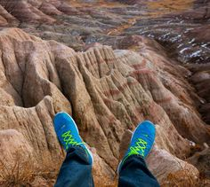 "#fromwhereistand in Badlands National Park South Dakota.  _  Or more like #whereisit on the edge of a cliff. It's a few hundred feet down.  _  Is your weekend just as crazy?  _  If you're interested in planning your own epic US road trip read our new article on travelwithbender.com ""US Road Trip Guide: My 10 Point Checklist"". _  #motherofallroadtrips  #southdakota  #DoBigThings  #visitrapidcity"
