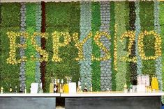 """""""One wall of the venue is designed as a branded living wall made from drought-resistant succulents, created by Nature's Rentals. The company's logo is written horizontally and vertically. The wall can be reinstalled in the company's main office as a permanent installation with an irrigation system after the event."""""""